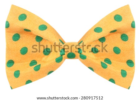 Hair bow tie yellow with green dots - stock photo