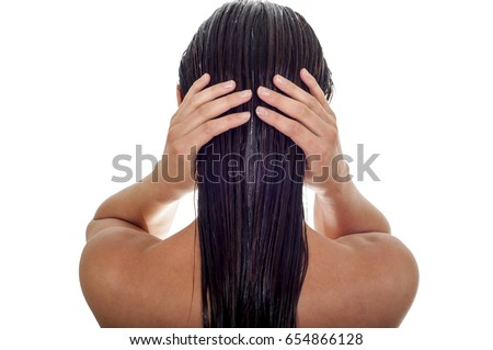 Hair care concept. Back view of woman with long wet hair, white background