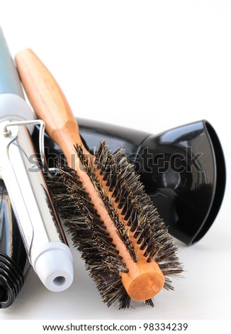 Hair dryer and brush on a white background - stock photo