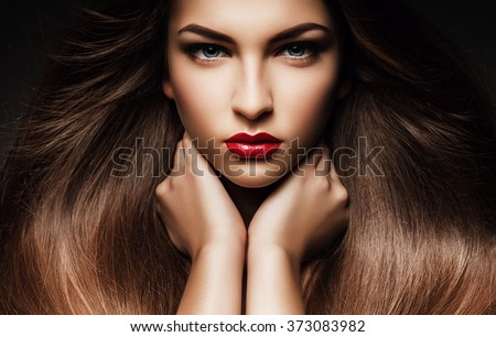 Hair, healthy long hair, hairstyle, make up. Beautiful woman with long hair, blue eyes and red lips - stock photo