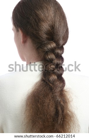 Hair in braid. Woman back with braided hair. Brown hairs tressed in long plait.