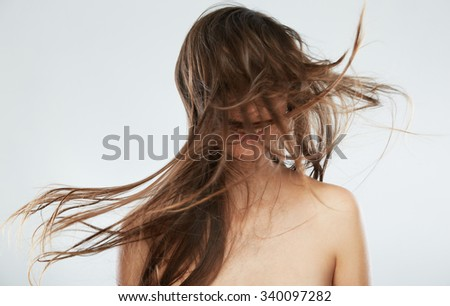 Hair style smiling woman portrait.Hair in motion. Female model isolated on white background.  - stock photo