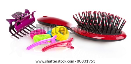 Hairbrush, barrette and Scrunchy isolated on white - stock photo
