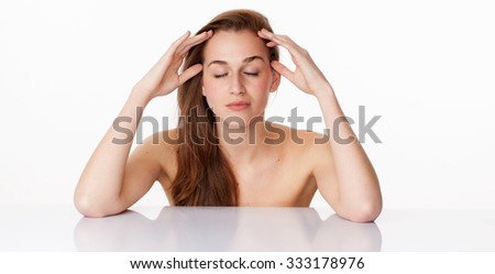haircare and skincare concept - elegant 20s woman with long brown hair closing her eyes,touching her face on clear white glass for relaxation and meditation,studio shot - stock photo