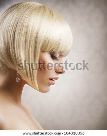 Haircut. Beautiful Girl with Healthy Short Blond Hair. Hairstyle - stock photo