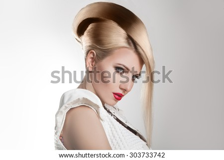 Haircut. Beautiful Girl with Healthy Short Blond Hair. Hairstyle. Studio shot. Horizontal - stock photo