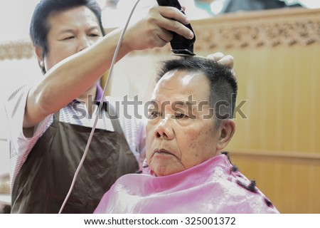 haircut The sight of  barber Thai man stools to work. thailand