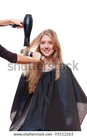 hairdresser blow dry hair. isolated on white background - stock photo
