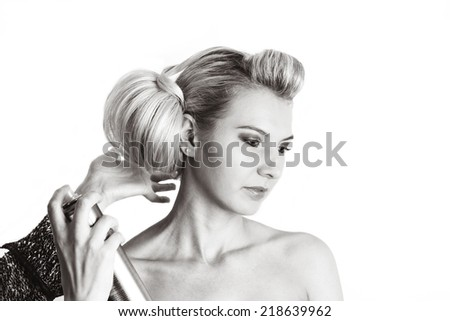 Hairdresser hand using hairspray adjusting hair dress - stock photo