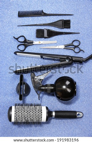 Hairdressing tools on blue background  - stock photo