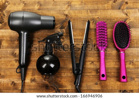Hairdressing tools on wooden table close-up - stock photo