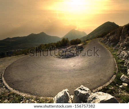 hairpin mountain road to the Lovcen National Park, Montenegro - stock photo