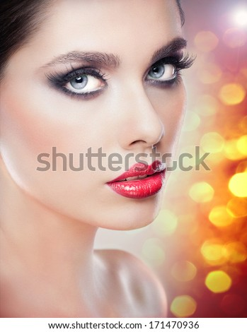 Hairstyle and Make up - beautiful female art portrait with beautiful eyes. Elegance. Genuine Natural brunette in studio. Portrait of a attractive woman with red lips and naked shoulders