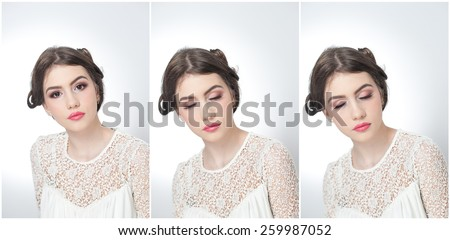 Hairstyle and make up - beautiful young girl art portrait with closed eyes. Genuine natural brunette, studio shot. Attractive female with beautiful lips in white lace blouse, over white background - stock photo