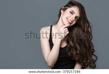 Hairstyle. Beauty fashion girl model portrait. Healthy Long Hair. Attractive brunette young woman with makeup. - stock photo