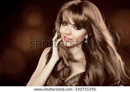 Hairstyle. Brown Hair. Attractive smiling girl with long Curly Hair. Happy smiling woman. - stock photo