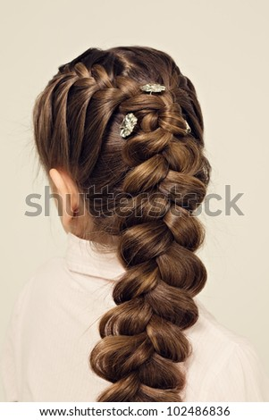 hairstyle portrait of beautiful girl with creative braid hairdo - stock photo