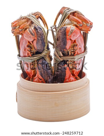 Hairy crabs on the Bamboo steamer Isolated in white background