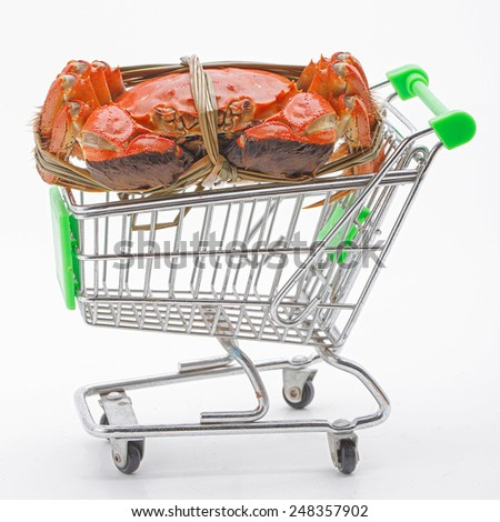 Hairy crabs on the shopping cart isolated in white background  - stock photo