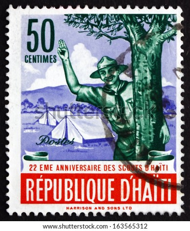 HAITI - CIRCA 1962: a stamp printed in Haiti shows Scout Giving Scout Sign, 22nd Anniversary of the Haitian Boy Scouts, circa 1962 - stock photo