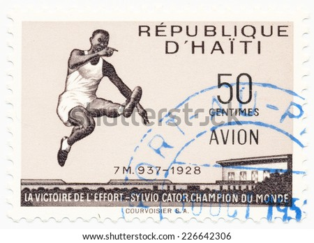 HAITI - CIRCA 1958: A stamp printed in Haiti shows Sylvio or Silvio Paul Cator (1900-1952) was a Haitian athlete most successful in the long jump, circa 1958 - stock photo