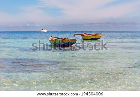 Haitian Fishing Boats: Old fishing boats near Labadee, Haiti