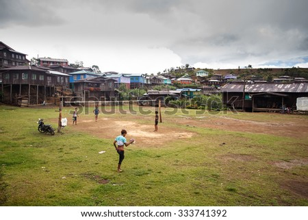 HAKHA, MYANMAR - JUNE 19 2015: Local children playing football in the Hakha region in Chin State, Myanmar. - stock photo