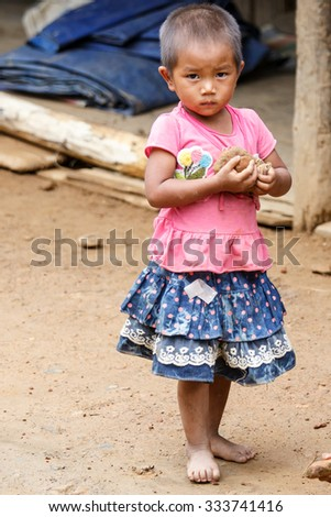 HAKHA, MYANMAR - JUNE 19 2015: Local girl in the Hakha region in Chin State, Myanmar. - stock photo