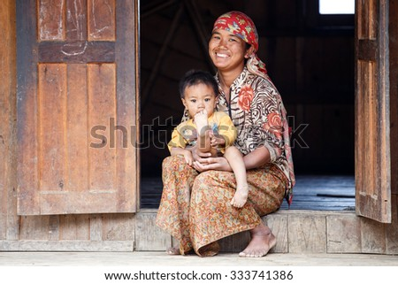 HAKHA, MYANMAR - JUNE 19 2015: Local woman and child in the Hakha region in Chin State, Myanmar. - stock photo