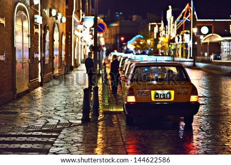 HAKODATE, JAPAN - OCTOBER 24: Taxis at warehouses on October 24, 2012 in Hakodate, JP. The city opened in 1859 as one of the first trading ports of Japan and the warehouses remain from that time.