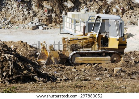 Hal Far, Malta July 16, 2015: Land development being carried out with a bulldozer at rest for a while. - stock photo