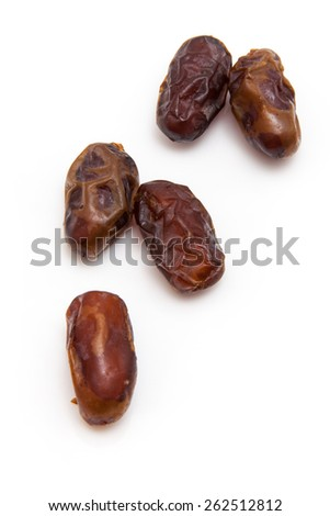 "Halawi dates isolated on a white background.  Halawi dates originate from date trees in the deserts and farms of Iraq. Halawi means ""sweet"" in Arabic - stock photo"