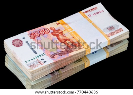 Half a million of Russian paper money 5000 rubles on the mirror. Isolated on a black background