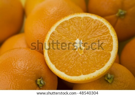 Half a navel Orange ready to squeeze - stock photo