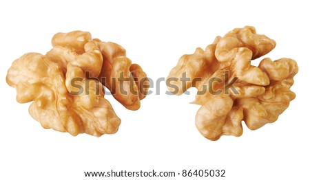 Half a walnuts shelled on a white background - stock photo