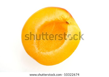 half an apricot isolated on white background - stock photo