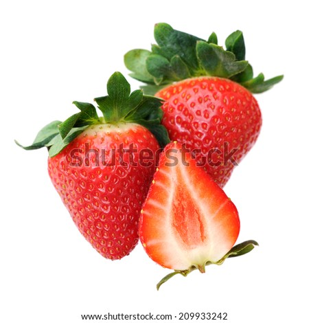half and whole section of strawberry isolated on white  - stock photo