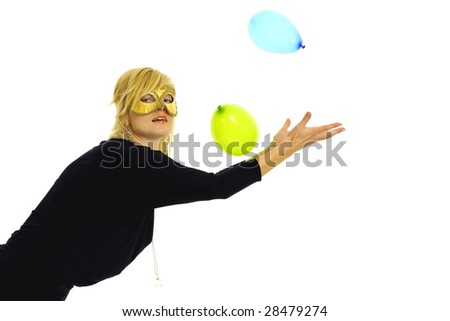 Half body view or lovely blond woman wearing golden mask and playing with balloons. Isolated on white background. - stock photo