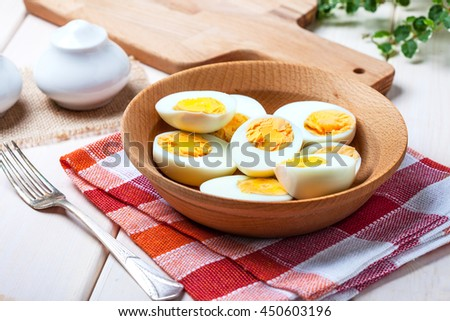 Half-boiled eggs in a wooden bowl. Selective focus. - stock photo
