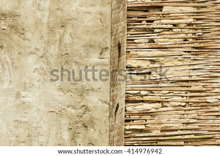half broken bamboo lath and stucco wall in Thailand - stock photo