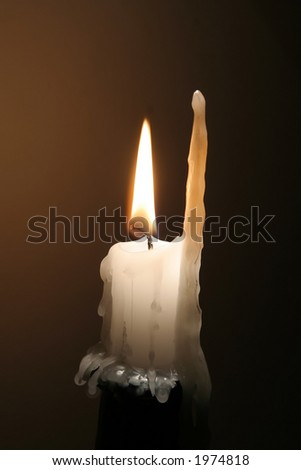 Half burned lighted candle