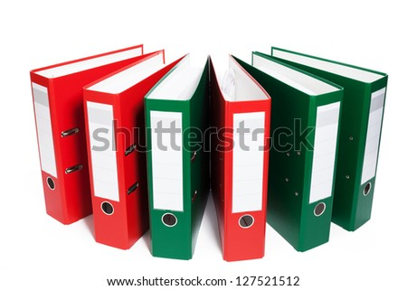 half circle of red and green ring binders on white background - stock photo