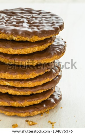 Half coated chocolate biscuits
