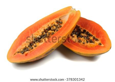Half cut and whole papaya fruits isolated on white background - stock photo