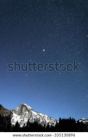 Half dome at Yosemite on a clear, starry, winter night - stock photo