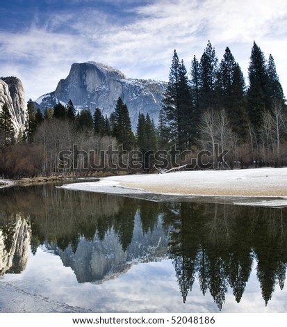 Half Dome reflected in lake in Yosemite National Park