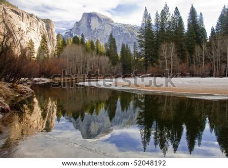 Half Dome reflected in lake in Yosemite National Park - stock photo