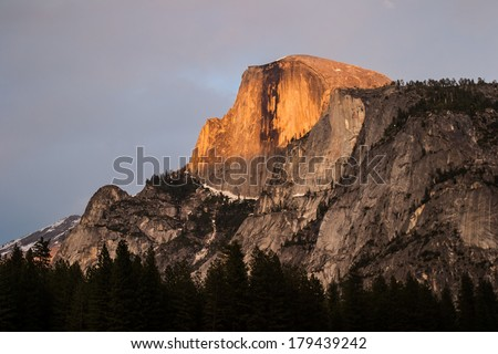 Half Dome rises more than 4,730 feet from the floor of Yosemite Valley in Yosemite National Park, California. This famous granite dome is a popular among hikers and top rock climbers. - stock photo