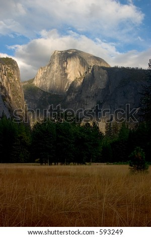 Half Dome viewed from a meadow in Yosemite Valley, just East of the village. - stock photo