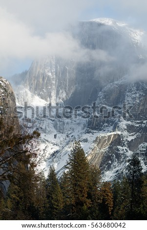 Half Dome with snow and clouds, California, Yosemite National Park
